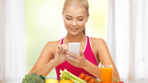 woman with fruits, vegetables and smartphone
